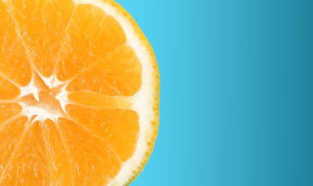 Orange slice over blue background. Isolated image Stock Photo - 6196273