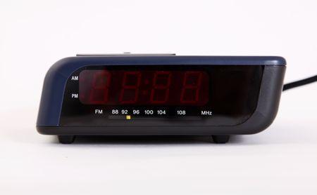 am radio: Alarm clock over white background. Time machine