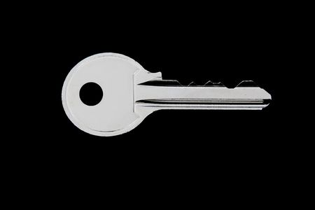 One key over black background. Only one object Stock Photo - 6268394