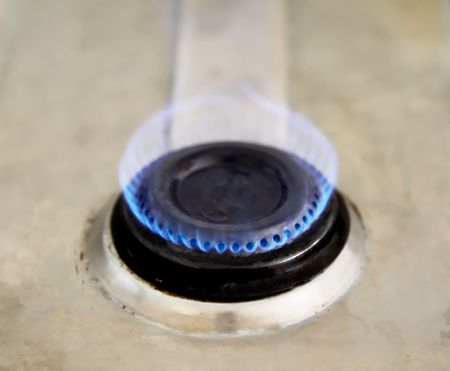 Blue flame of an old gas stove. High view photo