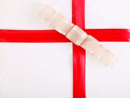 Red ribbon with ornament over white background. Gift image Stock Photo - 6268425