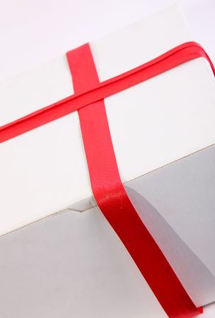 White box with red ribbon. Gift image Stock Photo - 6268461