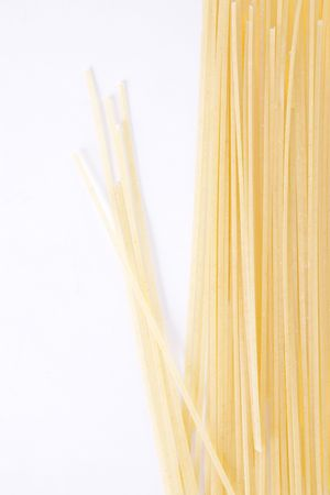 Raw spaghetti over white background. Food image photo