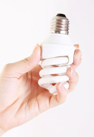 White light bulb on woman hand over empty background photo