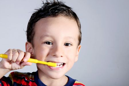 A four year old child brushing his teeth. Oral care Stock Photo - 6598050