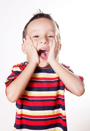 kid friendly: Child expressing surprise and happiness with his hands in his face Stock Photo