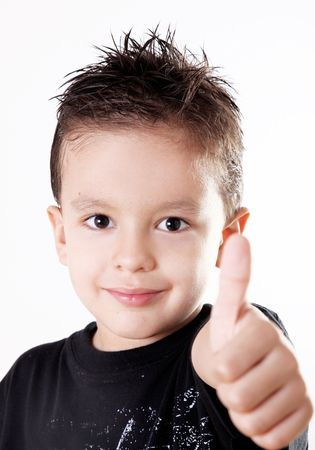 positive feelings: 5 years old child doing a positive signal with his hand.ok attitude Stock Photo