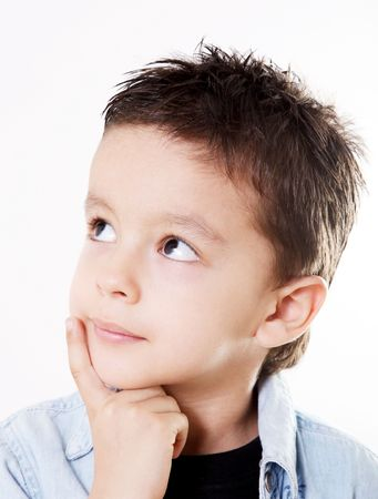 child looking up: Child thinking and looking happy with hand on his face