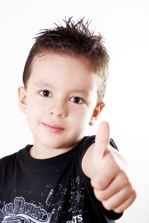 five year: Child doing a positive signal with his hand.ok attitude expressing happiness