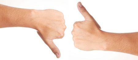 Two hands, with thumbs upward and downward Stock Photo - 6661250