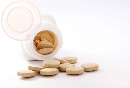 white pills and bottle on light background   Stock Photo - 6688383