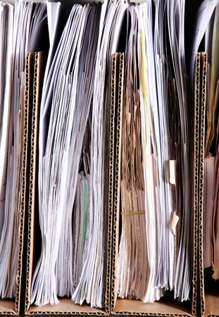 Many papers in cardboard folders. Image of office work photo