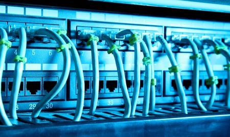Network cables with blue light. Technology image Stock Photo - 6790475
