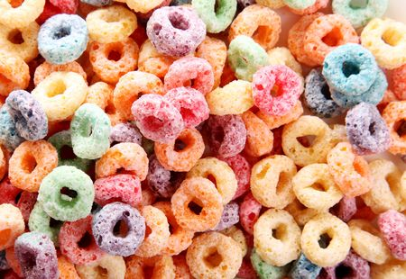 Orange, yellow, blue, and green fruit cereal photo