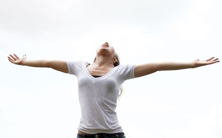 hands in the air: Young woman with outstretched arms expressing freedom Stock Photo
