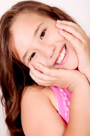 ten year old: Ten yeras old girl smiling and looking at camera Stock Photo