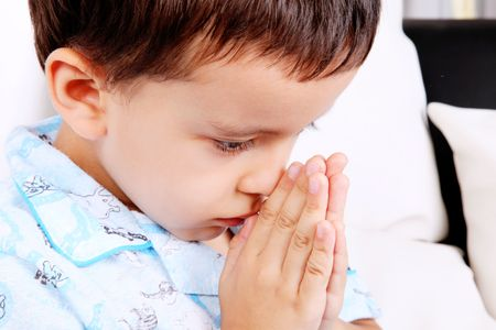 jesus adolescent: Child with his hands in prayer position Stock Photo