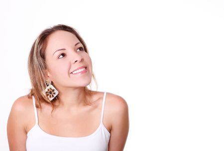 Woman smiling and  looking up over white background. Space to insert text or design photo