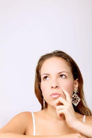 Young woman looking up and thinking. Space to insert text or design Stock Photo - 6877129