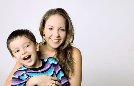 Mother and son looking at camera and smiling, space to insert text or design Stock Photo - 10002680