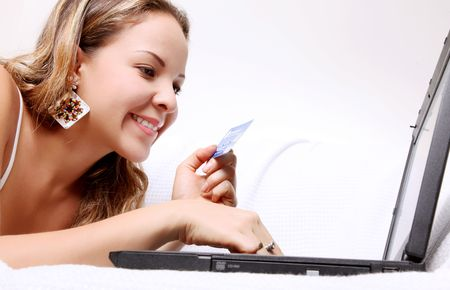 Young woman shopping with your credit card through the internet Stock Photo - 6877133