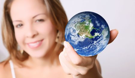 Woman with the world in her hands Stock Photo - 6877139