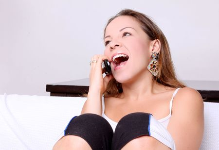 Woman talking and laughing on his cell phone. White Background photo