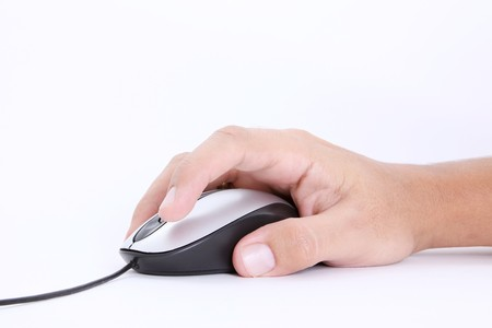 clique: Computer mouse over white background. Technology image Stock Photo