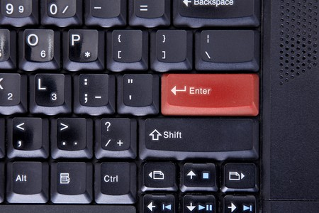 Computer keyboard with red colored enter key Stock Photo - 6995655