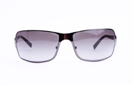 Black and gray sunglasses over white background. Isolated Stock Photo - 6995656
