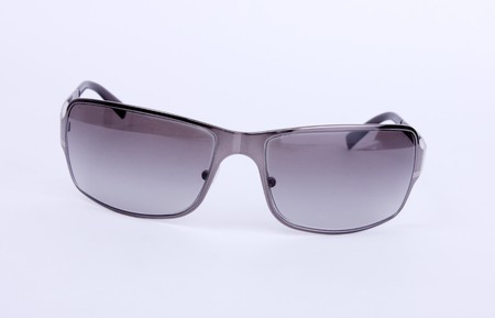 Black and gray sunglasses over white background. Isolated Stock Photo - 6995657