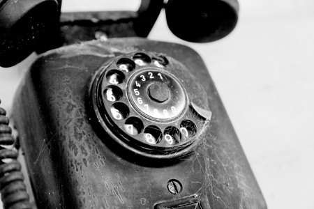 Old and black phone over gray background Stock Photo - 7064936
