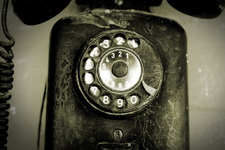 Old and black phone over black  background Stock Photo - 7064937