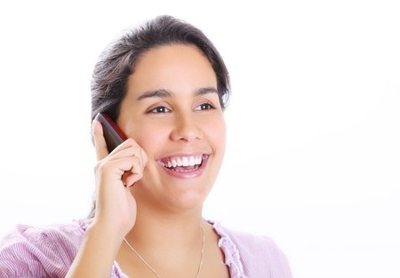 Young woman talking on cell phone. White background photo