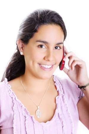 Young girl talking on her cell phone. White Background photo