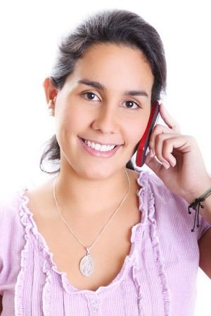 Young girl talking on her cell phone and smiling. White Background photo