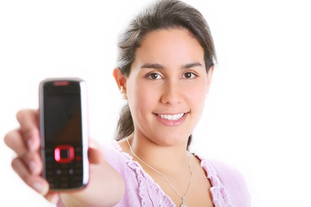 girl displaying her cell phone, looking at the camera and smiling, selective focus photo