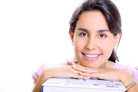 Smiling young girls face on several books photo