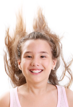 Ten years old girl with hair up over white background photo