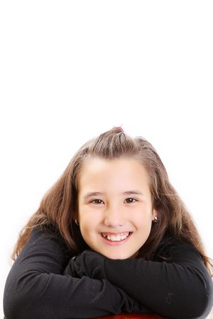 Girl on black smiling and looking the camera. Space to insert text or design photo