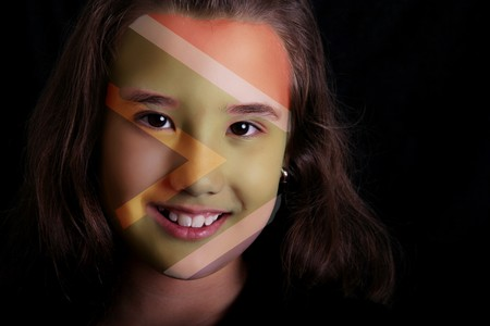 fanatic studio: Girl smiling and looking at the camera with south africa flag paint in her face Stock Photo