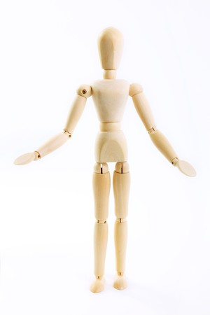 inquiry: wooden doll in an attitude of inquiry