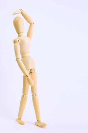 Wooden doll in an attitude of inquiry Stock Photo - 7549676