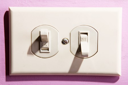 Light switch on pink wall. Energy box, on and off photo