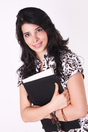Woman looking at the camera with some books over white background photo