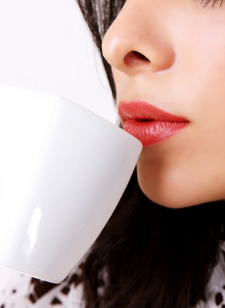Woman drinking coffee in a white cup Stock Photo - 7549694