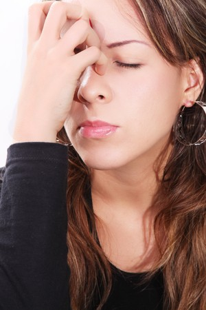 Troubled young woman with her hand on her face Stock Photo - 7739394