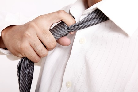 take away: Executive taking off his tie. white shirt Stock Photo