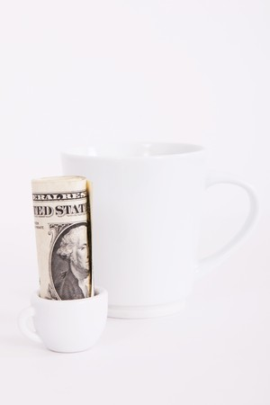 dolar: Big and small white cup, with one dolar, money concept