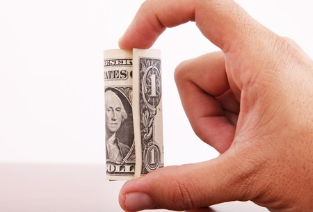 buy one: Hand with one dolar roll on white background, Money image
